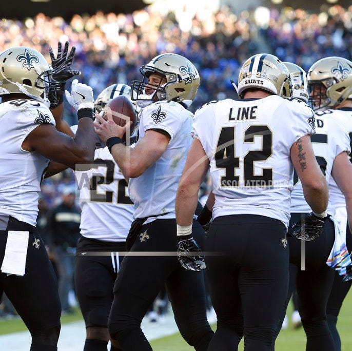 Brees comeback, missed extra point gets Saints past Ravens 24-23