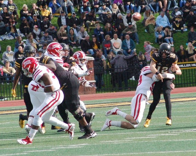 UL  linebacker Jacques Boudreaux tackles App State quarterback Zac Thomas on Saturday in Boone, North Carolina.