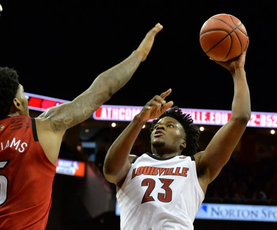 Louisville White Team center Steven Enoch (23) puts up a shot over the defense of center Malik Williams (5) during action of the Red - White Intrasquad Scrimmage, in Louisville Ky., Sunday, Oct. 21, 2018.