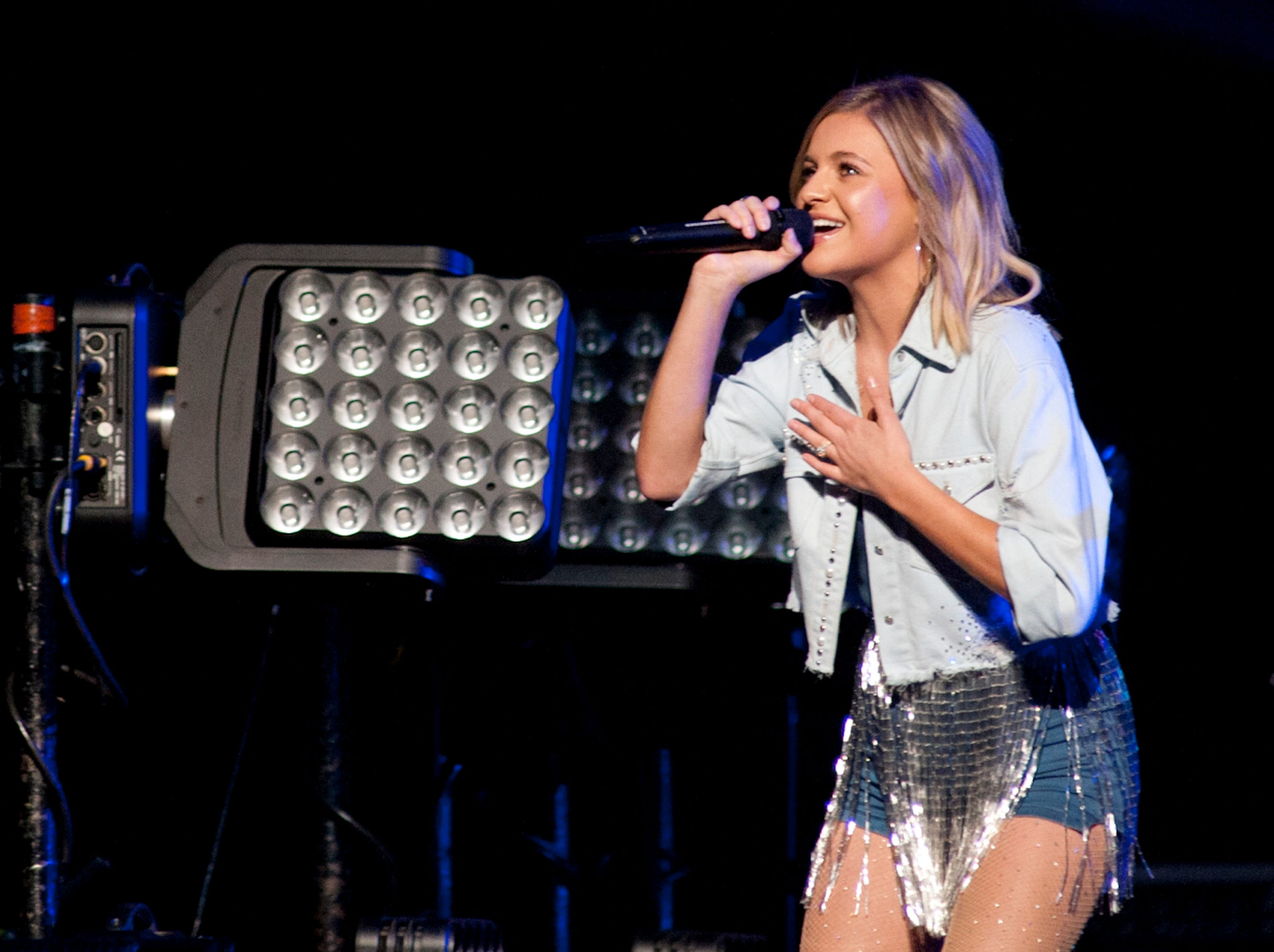 Kelsea Ballerini, the warm-up act for country musician Keith Urban, performs on the Yum Center stage. October 20, 2018