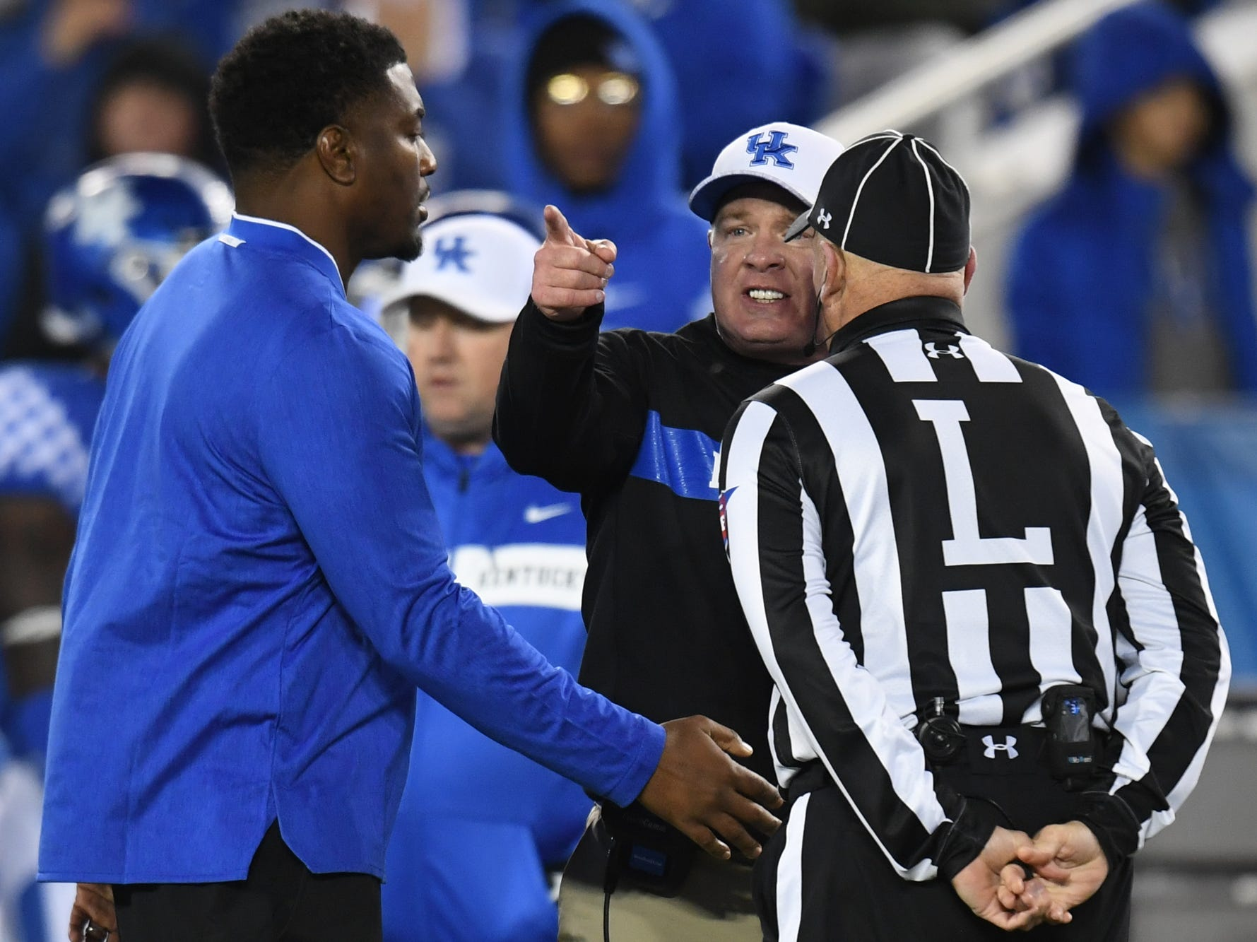 UK head coach Mark Stoops talks with an official during the University of Kentucky football game against Vanderbilt at Kroger Field in Lexington, Kentucky on Saturday, October 20, 2018.