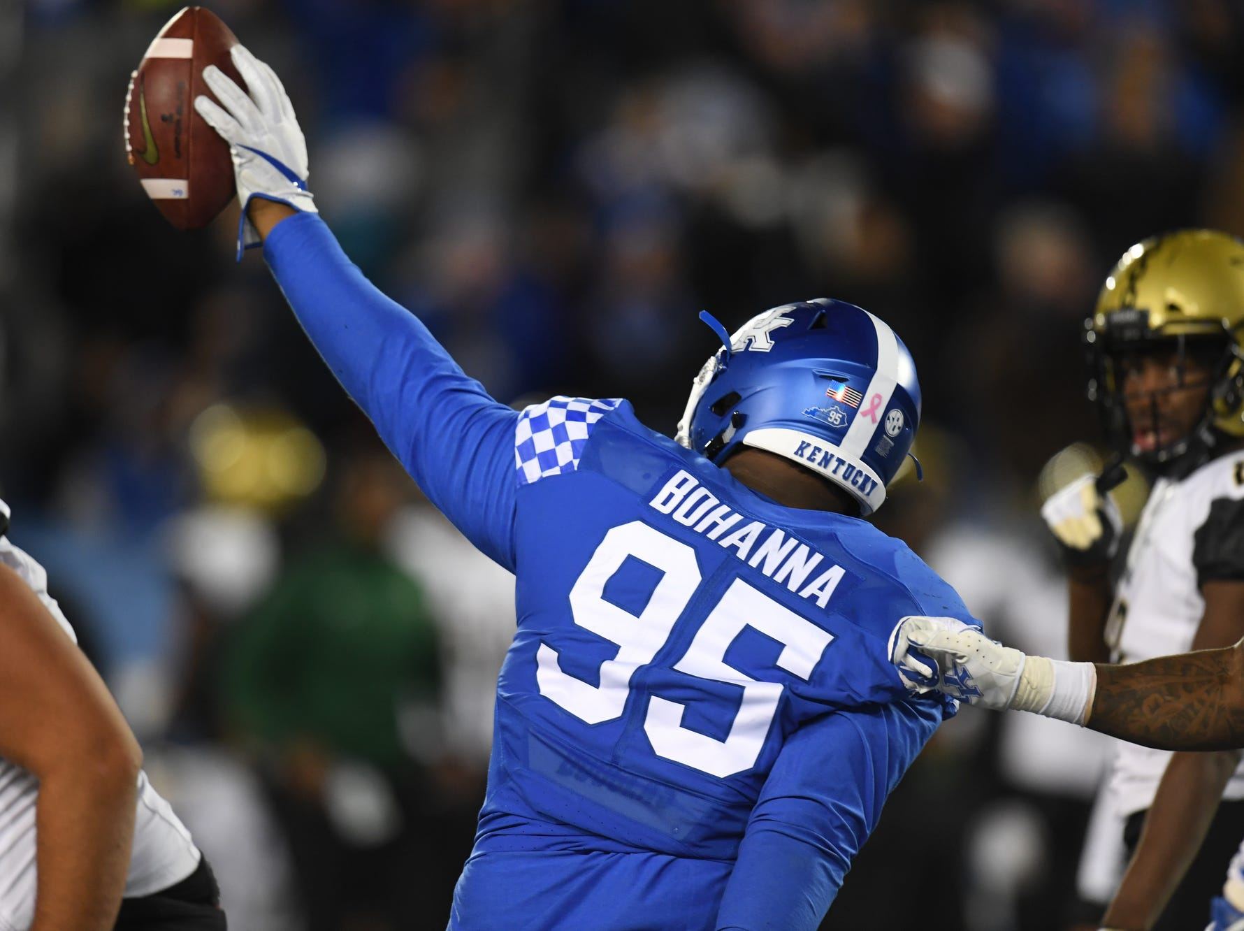 UK NG Quinton Bohanna recovers a fumble during the University of Kentucky football game against Vanderbilt at Kroger Field in Lexington, Kentucky on Saturday, October 20, 2018.