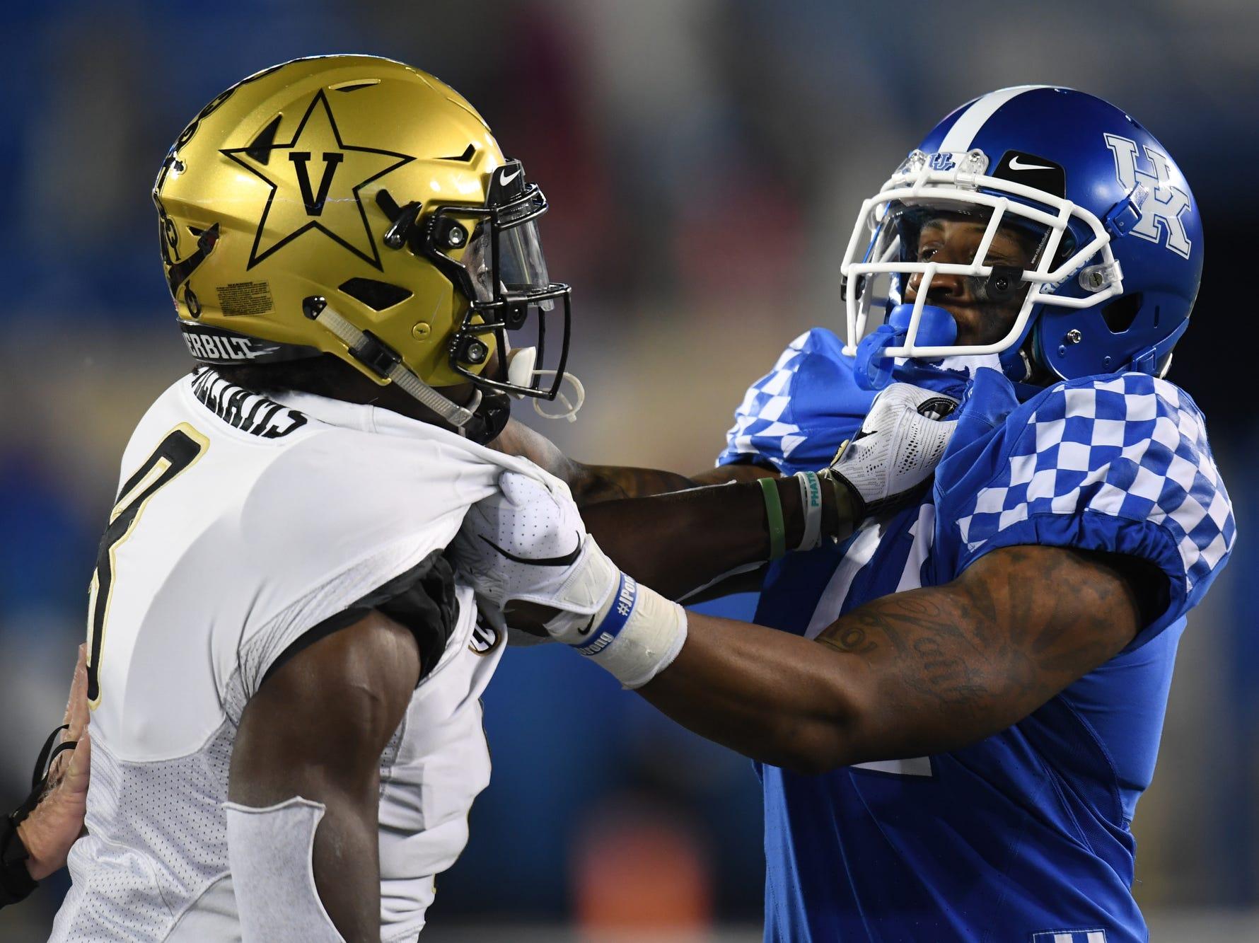 UK WR Tavin Richardson and Vanderbilt CB Joejuan Williams grab each other during the University of Kentucky football game against Vanderbilt at Kroger Field in Lexington, Kentucky on Saturday, October 20, 2018.
