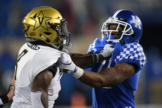 UK WR Tavin Richardson and Vanderbilt CB Joejuan Williams grab each other during the University of Kentucky football game against Vanderbilt at Kroger Field in Lexington, Kentucky on Saturday, October 20, 2018.
