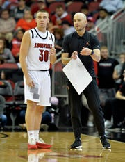 Louisville assistant coach Luke Murray talks with guard Ryan McMahon (30) during action of the Red - White Intrasquad Scrimmage, in Louisville Ky., Sunday, Oct. 21, 2018.