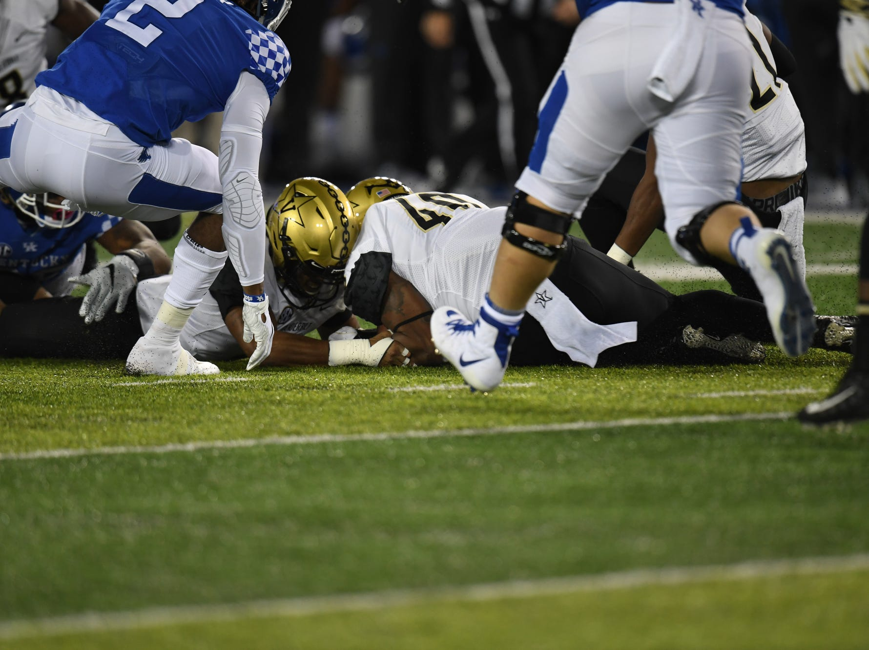 Vanderbilt recovers a fumble by UK QB Terry Wilson during the University of Kentucky football game against Vanderbilt at Kroger Field in Lexington, Kentucky on Saturday, October 20, 2018.
