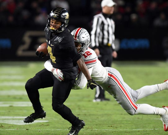 Oct 20, 2018; West Lafayette, IN, USA; Purdue Boilermaker receiver Rondale Moore (4) evades Ohio State buckeyes safety Isaiah Pryor (12) in the first half  at Ross-Ade Stadium. Mandatory Credit: Thomas J. Russo-USA TODAY Sports
