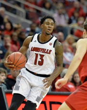 Louisville forward V.J. King (13) brings the ball up court during action of the Red - White Intrasquad Scrimmage on Sunday, Oct. 21, 2018.