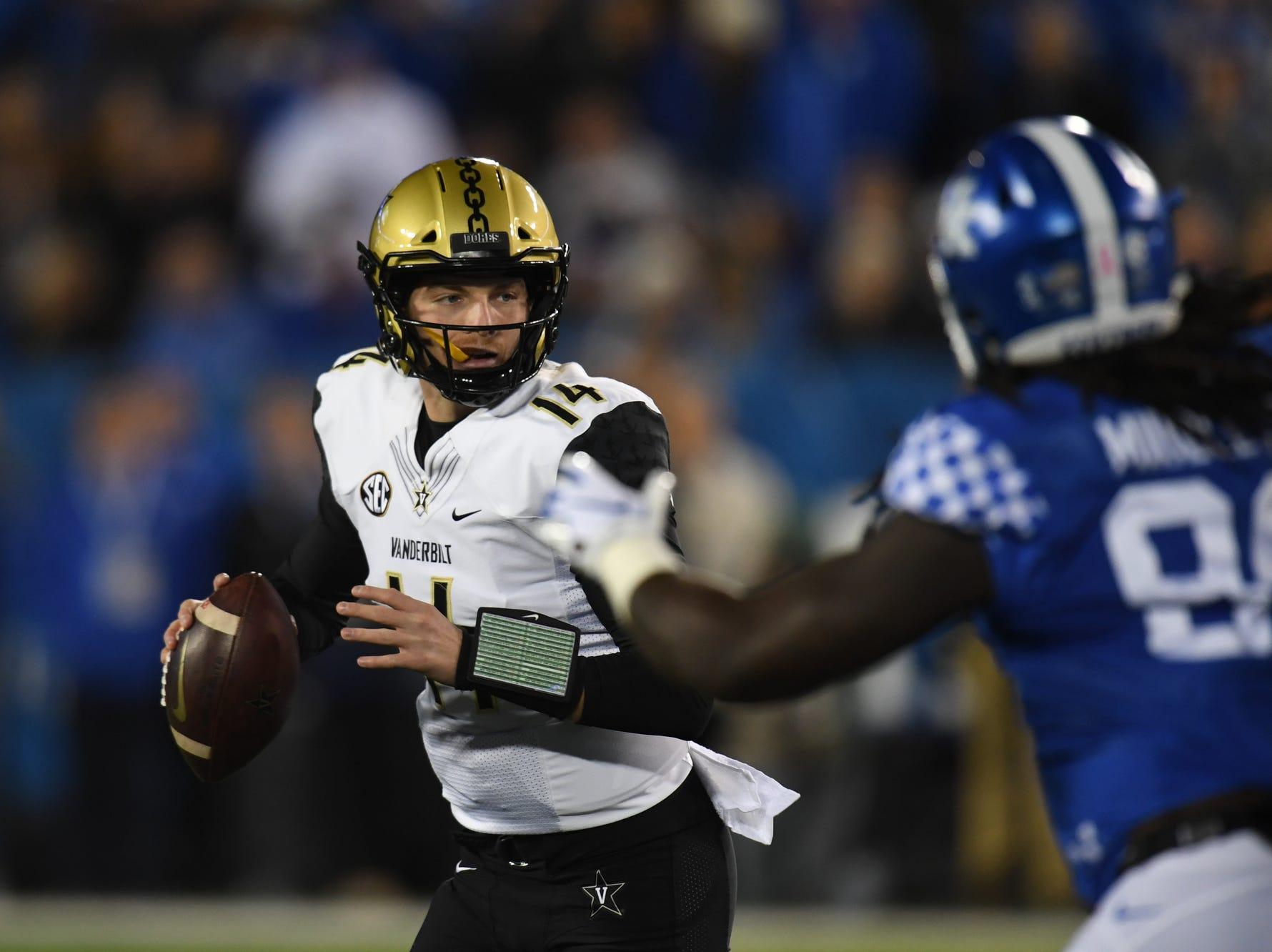 Vanderbilt QB Kyle Shurmur is pressured during the University of Kentucky football game against Vanderbilt at Kroger Field in Lexington, Kentucky on Saturday, October 20, 2018.
