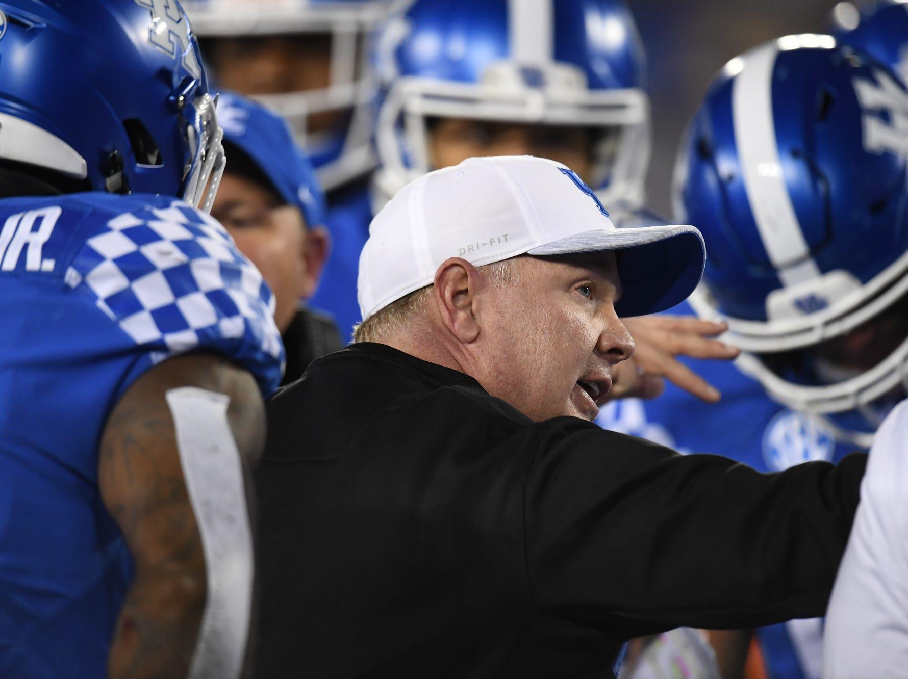 UK head coach Mark Stoops talks to the defense during the University of Kentucky football game against Vanderbilt at Kroger Field in Lexington, Kentucky on Saturday, October 20, 2018.