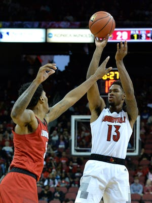 Louisville White Team forward V.J. King (13) shoots over the reach of center Malik Williams (5) during action of the Red - White Intrasquad Scrimmage, in Louisville Ky., Sunday, Oct. 21, 2018.