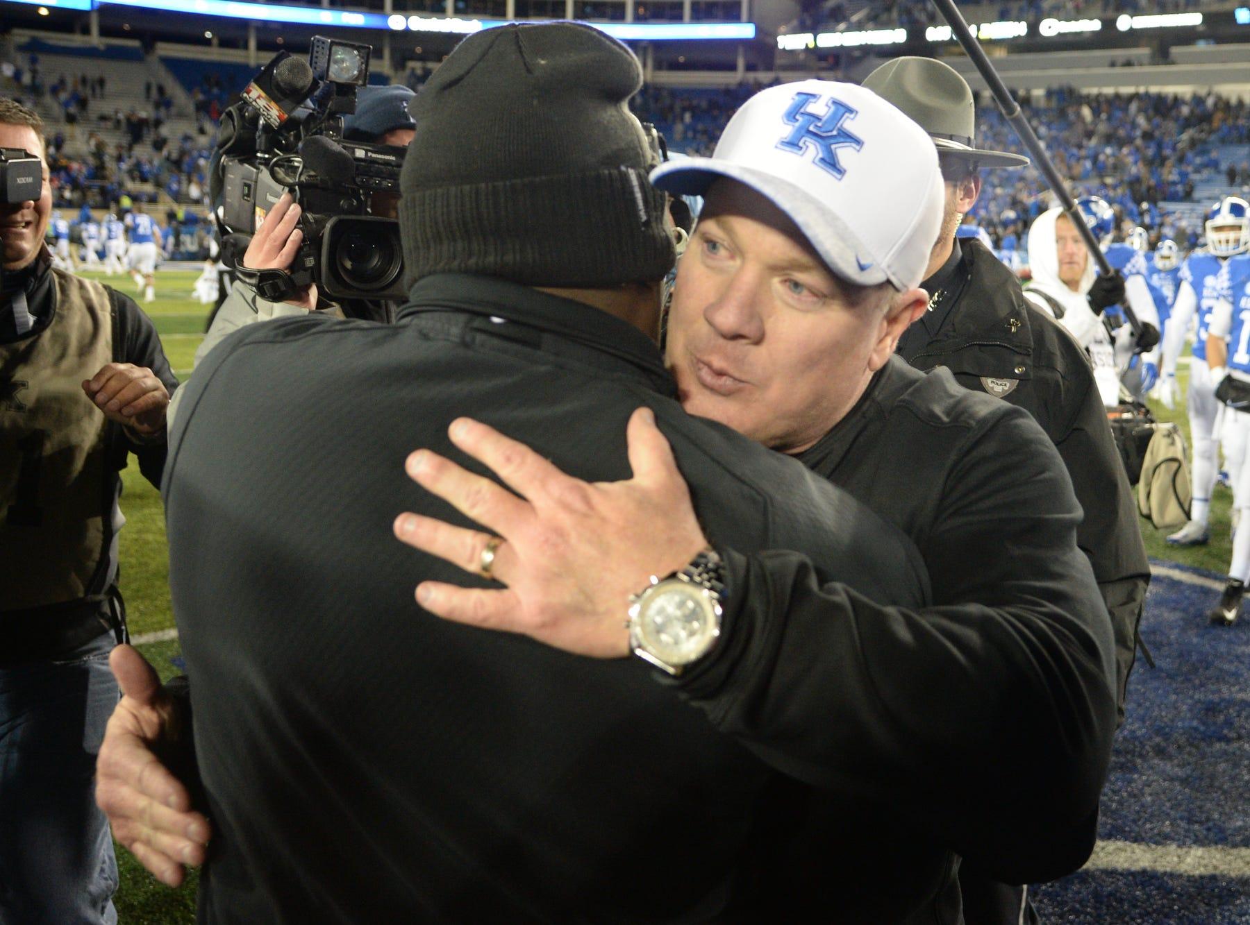 UK head coach Mark Stoops hugs Vanderbilt head coach Derek Mason after the University of Kentucky football game against Vanderbilt at Kroger Field in Lexington, Kentucky on Saturday, October 20, 2018.