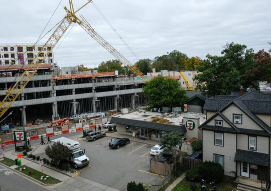 The Center City District in downtown East Lansing between Grand River Avenue and Albert Avenue is under construction and the signage indicates it will be open in the summer and fall of 2019. It is a mixed use project with student housing, office and retail as well as housing for people 55 and older. Oct. 21, 2018.