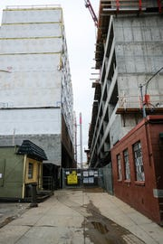 An alley separates two of the buildings at Center City District Project. Sunday, Oct. 21, 2018.