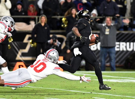 Purdue freshman Rondale Moore completes a 42-yard catch-and-run for a touchdown in the fourth quarter of Saturday's resounding win over Ohio State.