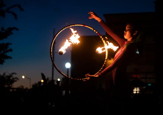 Fire spinner Christianne Clorina performs Oct. 20 during the Busted Knuckles Stunt Tour at Southern Thunder Harley-Davidson in Southaven.