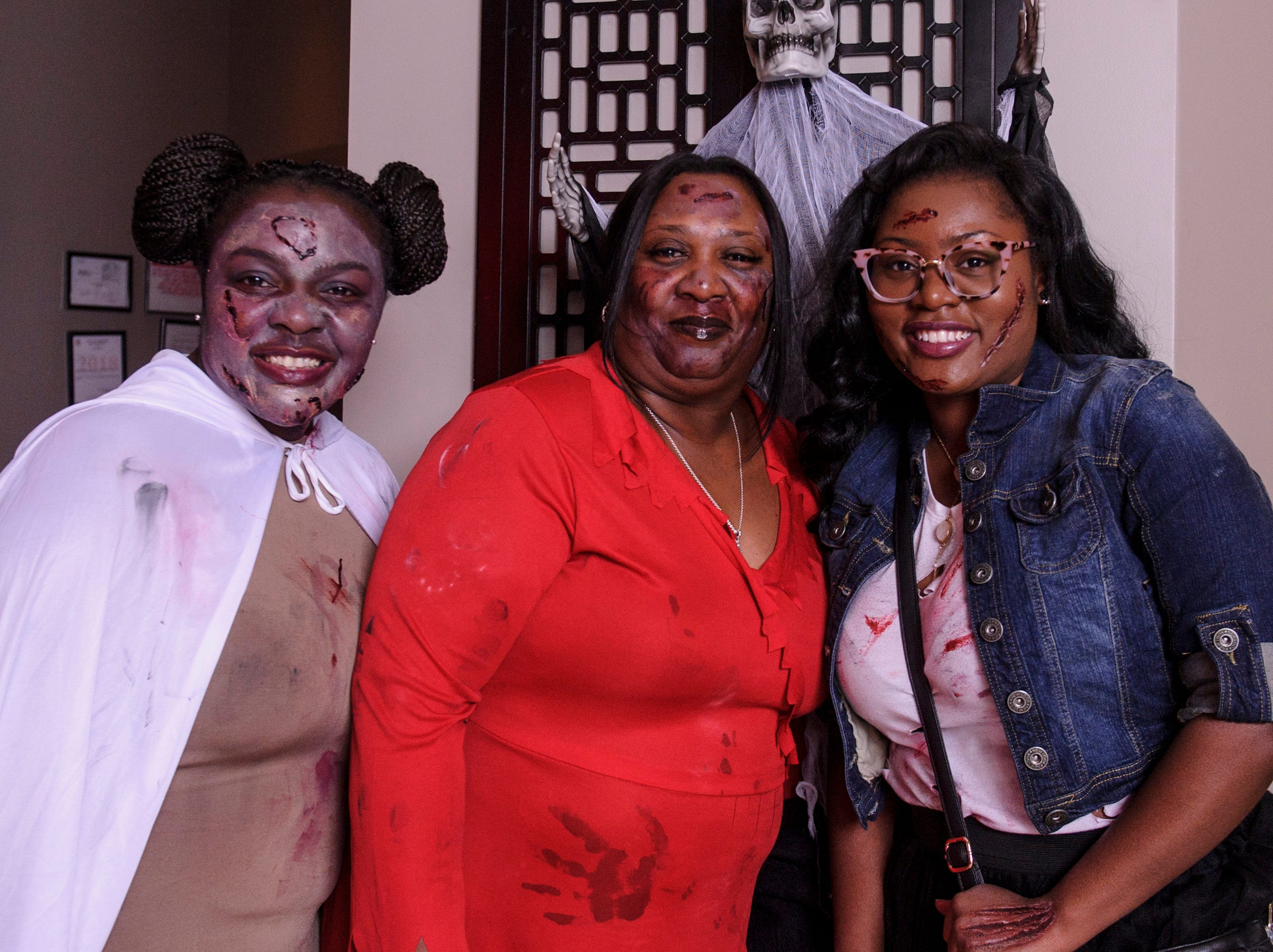 Dezanna Moore, Denozanna Moore, and Victavia Moore at the Zombie Prom on Saturday, Oct. 20, 2018.