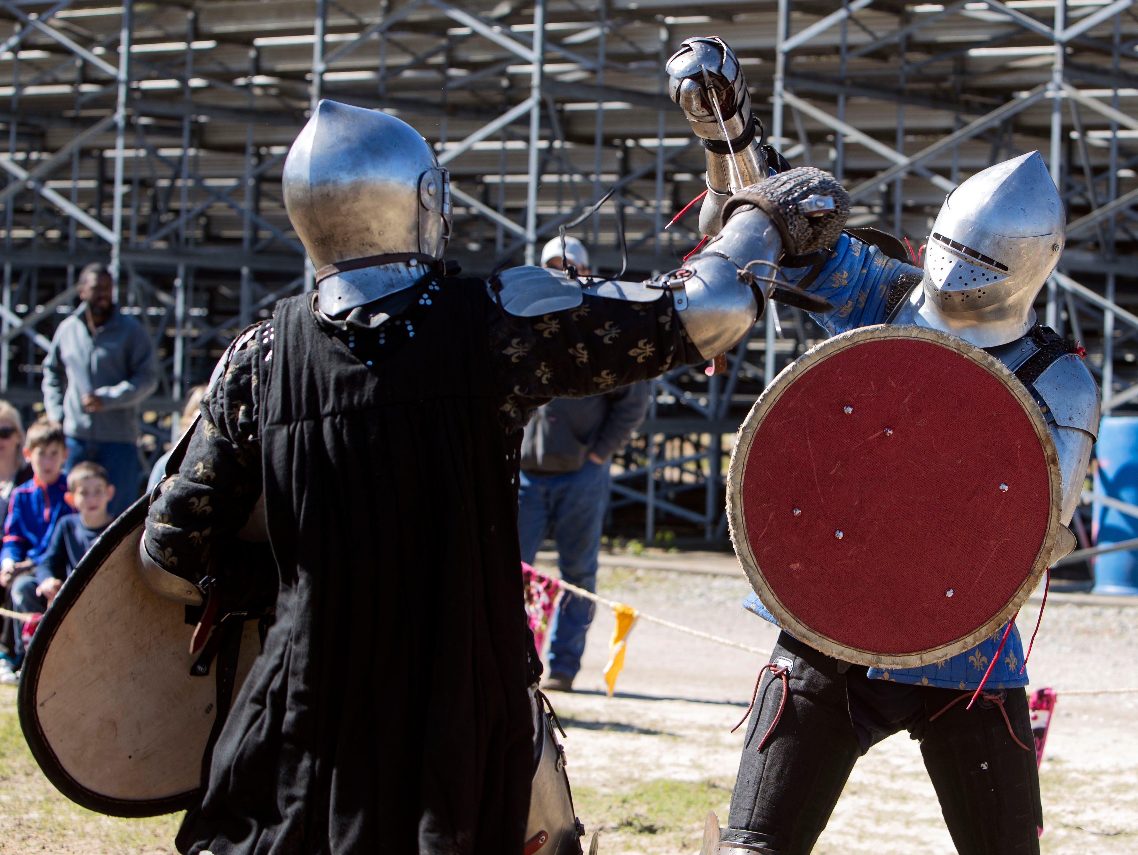 Powell Crider and Nick Home demonstrate a Amigard Combat League fighting Demonstration at the Mid South Renaissance Faire featured Sunday October 21,2018 in Millington, Tennessee.