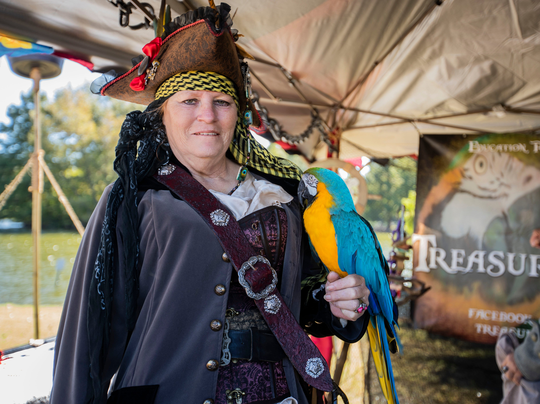 Lisbeth Redden shows off 'Treasure Parrots' parrots at the   Mid South Renaissance Faire Sunday October 21,2018.
