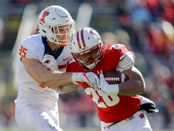UW tailback Taiwan Deal had 111 yards rushing and two touchdowns on just 12 carries Saturday against Illinois.