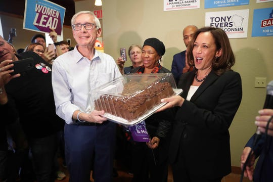 Democratic candidate for governor Tony Evers (left) holds a birthday cake for California Democrat Kamala Harris, a U.S. senator and likely 2020 presidential candidate who turned 54 on Sunday. A campaign rally was held at the Democratic Party north side campaign headquarters at 1801 N. King Drive in Milwaukee on Sunday.