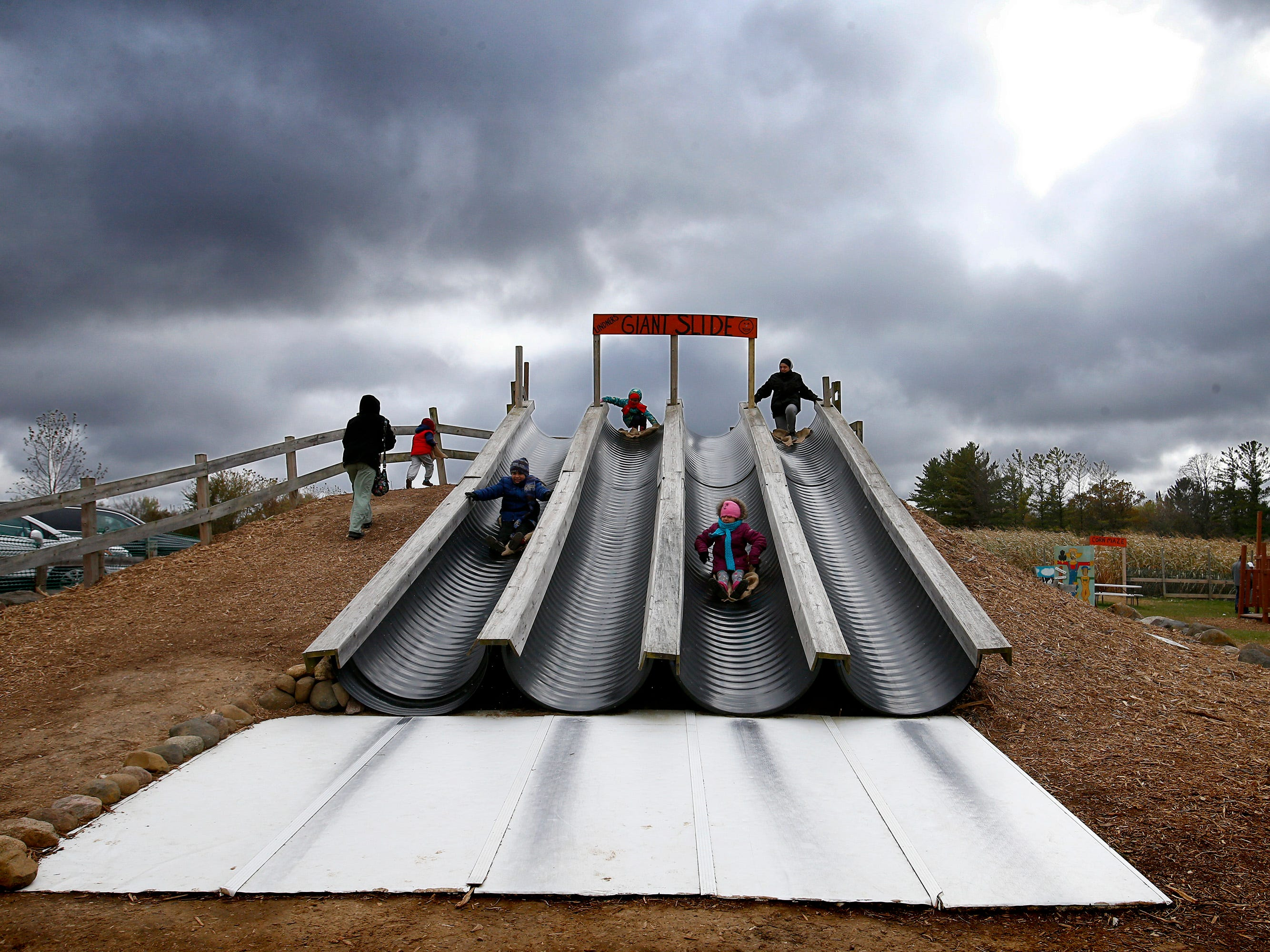 Families play on the Giant Slide at the Lindner Pumpkin Farm in New Berlin on Oct. 20.