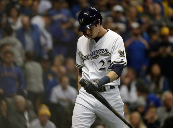 Christian Yelich is frustrated after striking out in the eighth inning in the Brewers' 5-1 loss to the Dodgers in Game 7 of the NLCS on Saturday night.