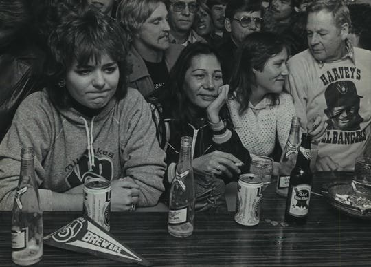 Fans commiserate at Cesar's Inn, a bar owned by Brewers manager Harvey  Kuenn, after the Brewers lose to St. Louis in Game 7 of the 1982 World Series on Oct. 20, 1982.