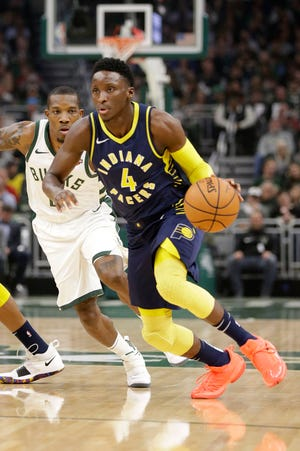 Bucks guard Eric Bledsoe fights around a screen while guarding the Indiana Pacers' Victor Oladipo.