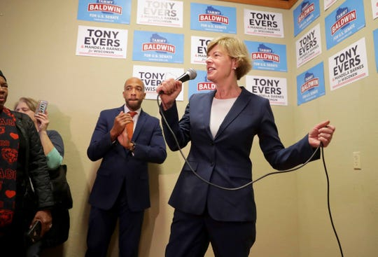 U.S. Sen. Tammy Baldwin answers questions from the media during a campaign rally that was held at the Democratic Party north side campaign headquarters at 1801 N. King Drive in Milwaukee on Sunday.