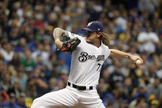 Brewers relief pitcher Josh Hader (71) pitches in the third inning.