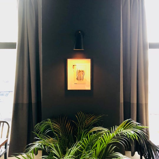 Plants, dark walls and larger windows are part of the new decor for 422 E. Lincoln Ave. in Bay View, the home of Voyager wine bar.