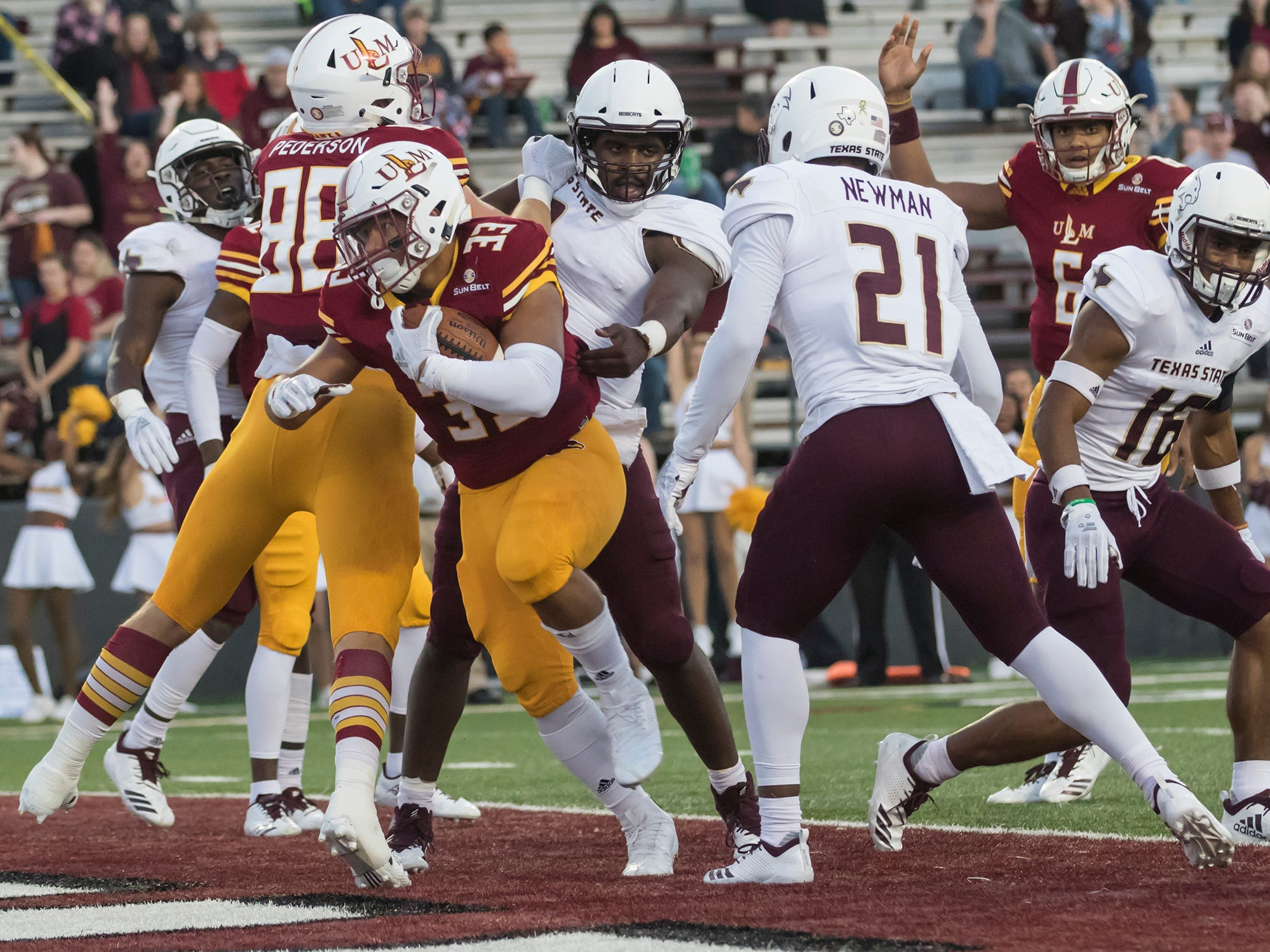 University of Louisiana at Monroe's Austin Vaughn (33) runs the ball in for ULM's first touchdown of game against Texas State University at Malone Stadium in Monroe, La. on Oct. 20.