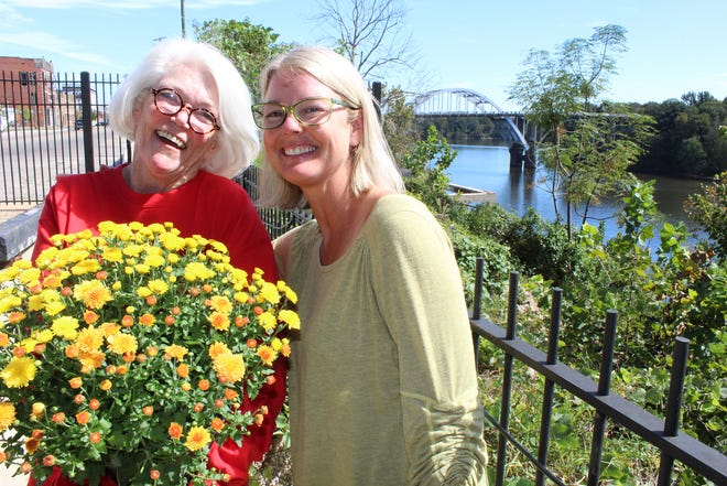 Debe Henry, left, and Becky Youngblood take advantage of beautiful weather at the Arts Revive facility in Selma.