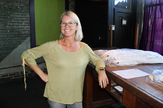 Arts Revive leader Becky Youngblood takes time out for a breather at her office overlooking the Alabama River in Selma.