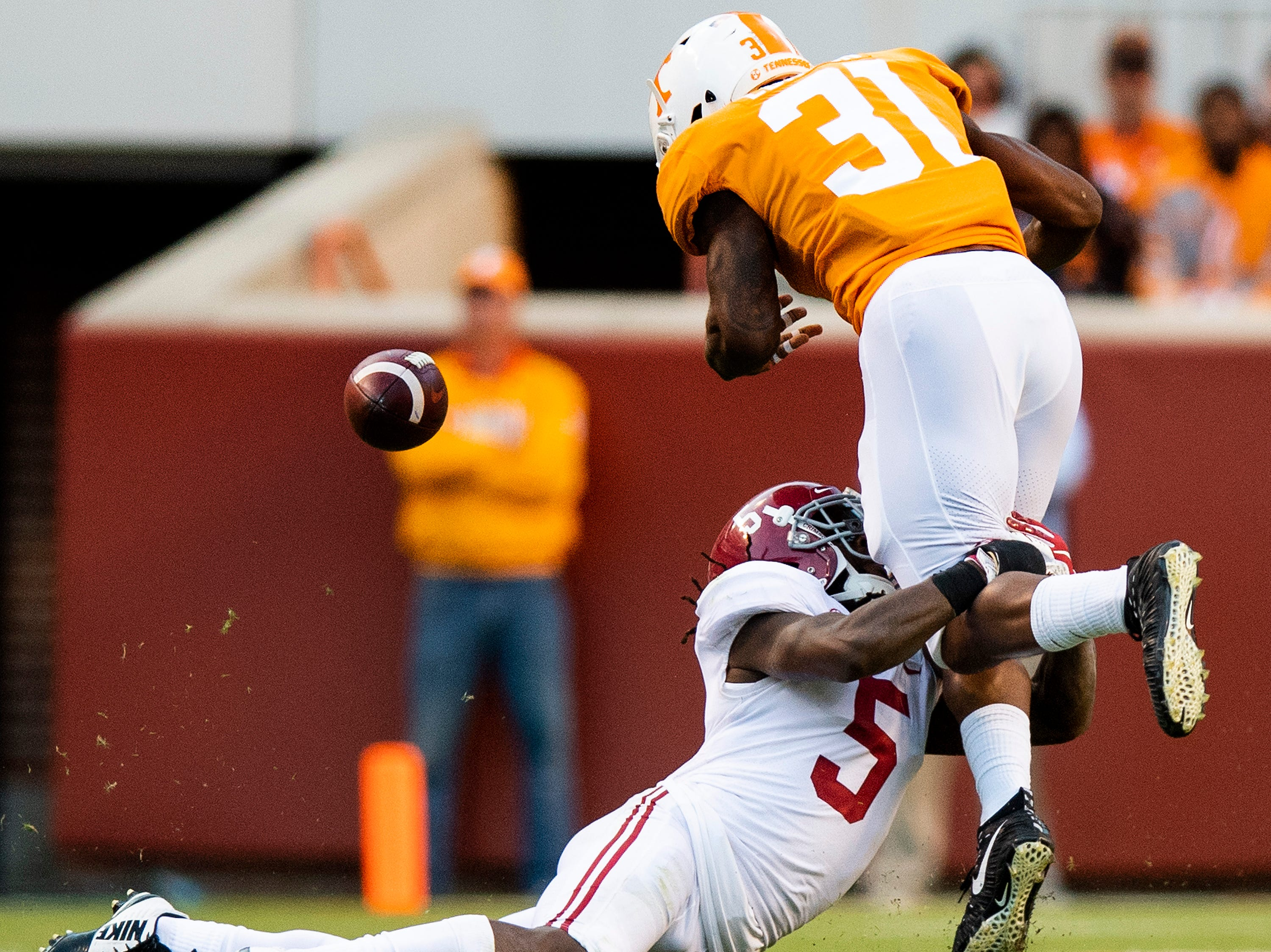 Alabama defensive back Shyheim Carter (5) causes a fumble by Tennessee running back Madre London (31) in second half action at Neyland Stadium in Knoxville, Tn., on Saturday October 20, 2018.