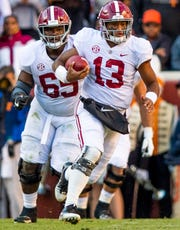 Alabama quarterback Tua Tagovailoa (13) rushes against Tennessee in first half action at Neyland Stadium in Knoxville, Tn., on Saturday October 20, 2018.
