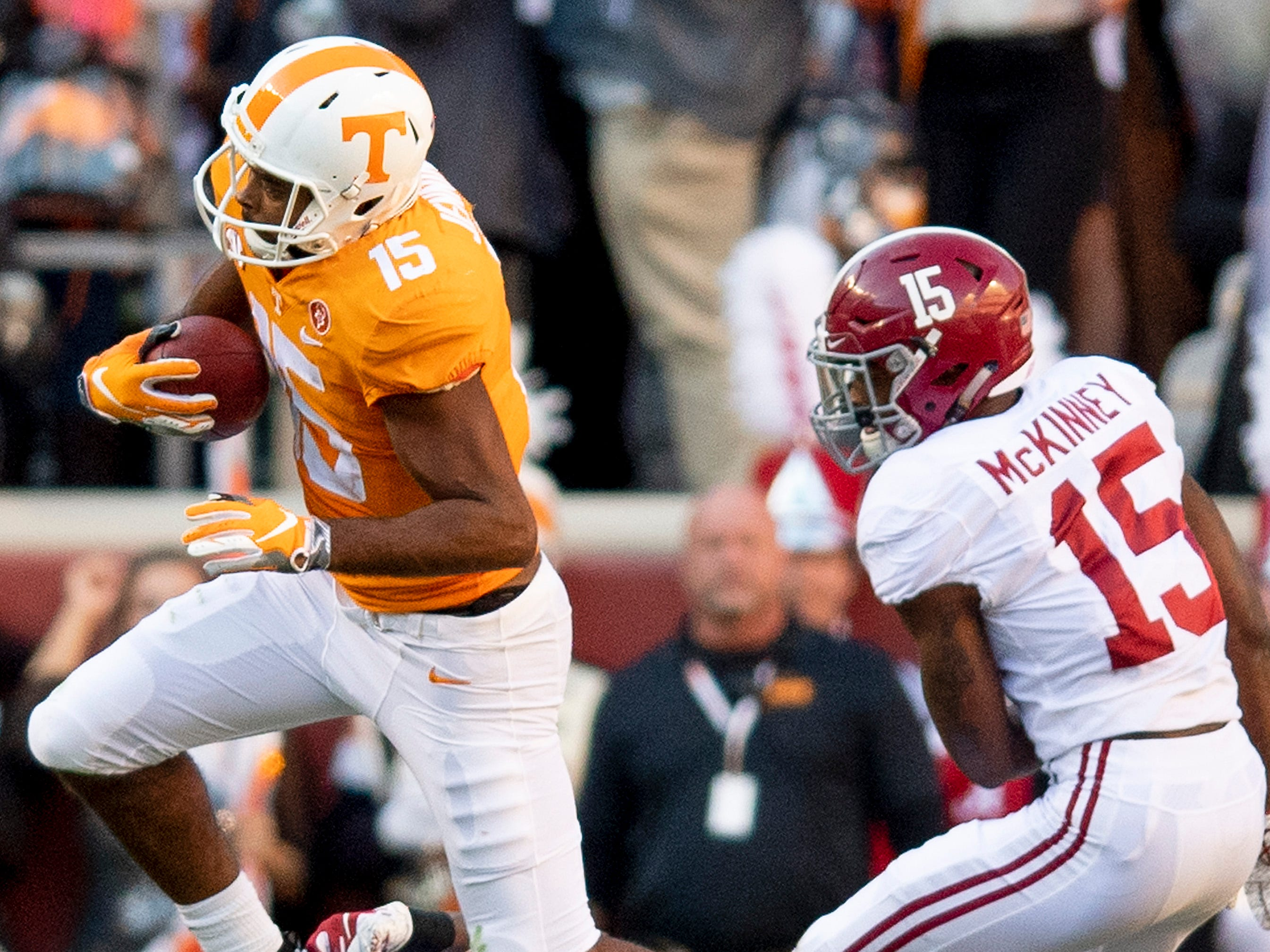 Tennessee wide receiver Jauan Jennings (15)  catches a pass against Alabama defensive backs Xavier McKinney (15) and Shyheim Carter (5) in first half action at Neyland Stadium in Knoxville, Tn., on Saturday October 20, 2018.