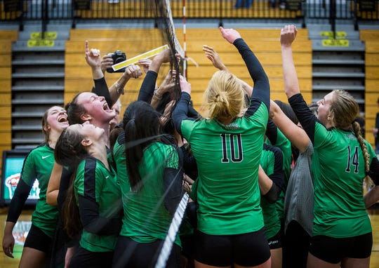 Yorktown celebrates defeating Fishers in their regional match at Noblesville High School Saturday, Oct. 20, 2018.