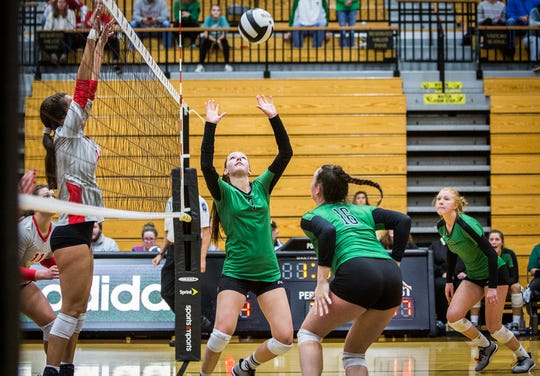 Yorktown's Kate Vinson sets the ball during a 2018 regional championship victory over Fishers.