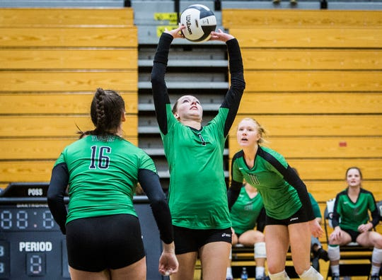 Yorktown's Kate Vinson sets against Fishers' defense during their regional game at Noblesville High School Saturday, Oct. 20, 2018.