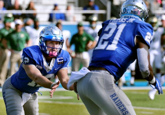 MTSU's quarterback Brent Stockstill (12) tosses the ball to Tavares Thomas (21) during the Homecoming game against Charlotte, on Saturday, Oct. 20, 2018.