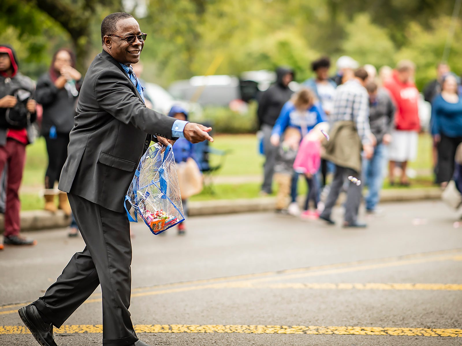 Dr. McPhee passes out candy at the parade.