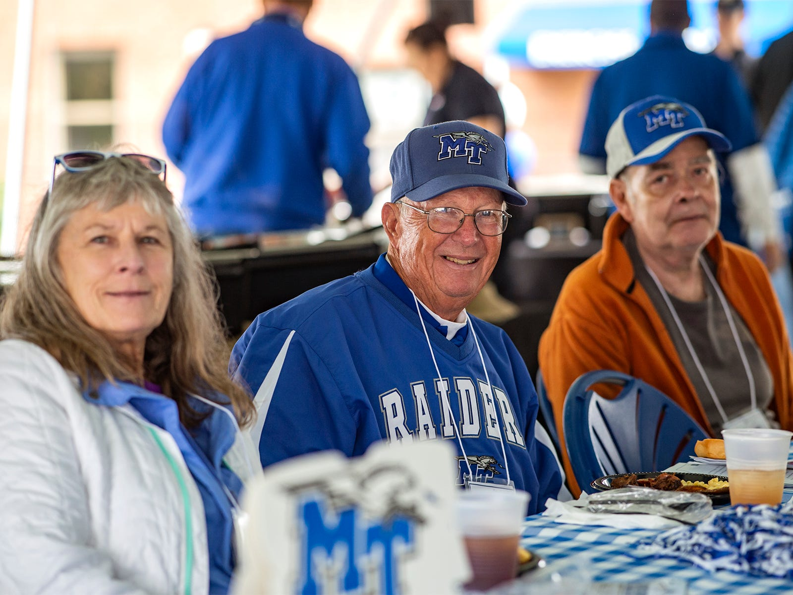 "Golden Raiders enjoy the Alumni tailgate luncheon after the parade.  L to r: Kathy ""Kitty: Peterson ('68), Carl Reid ('68), James Ledbetter ('68)"