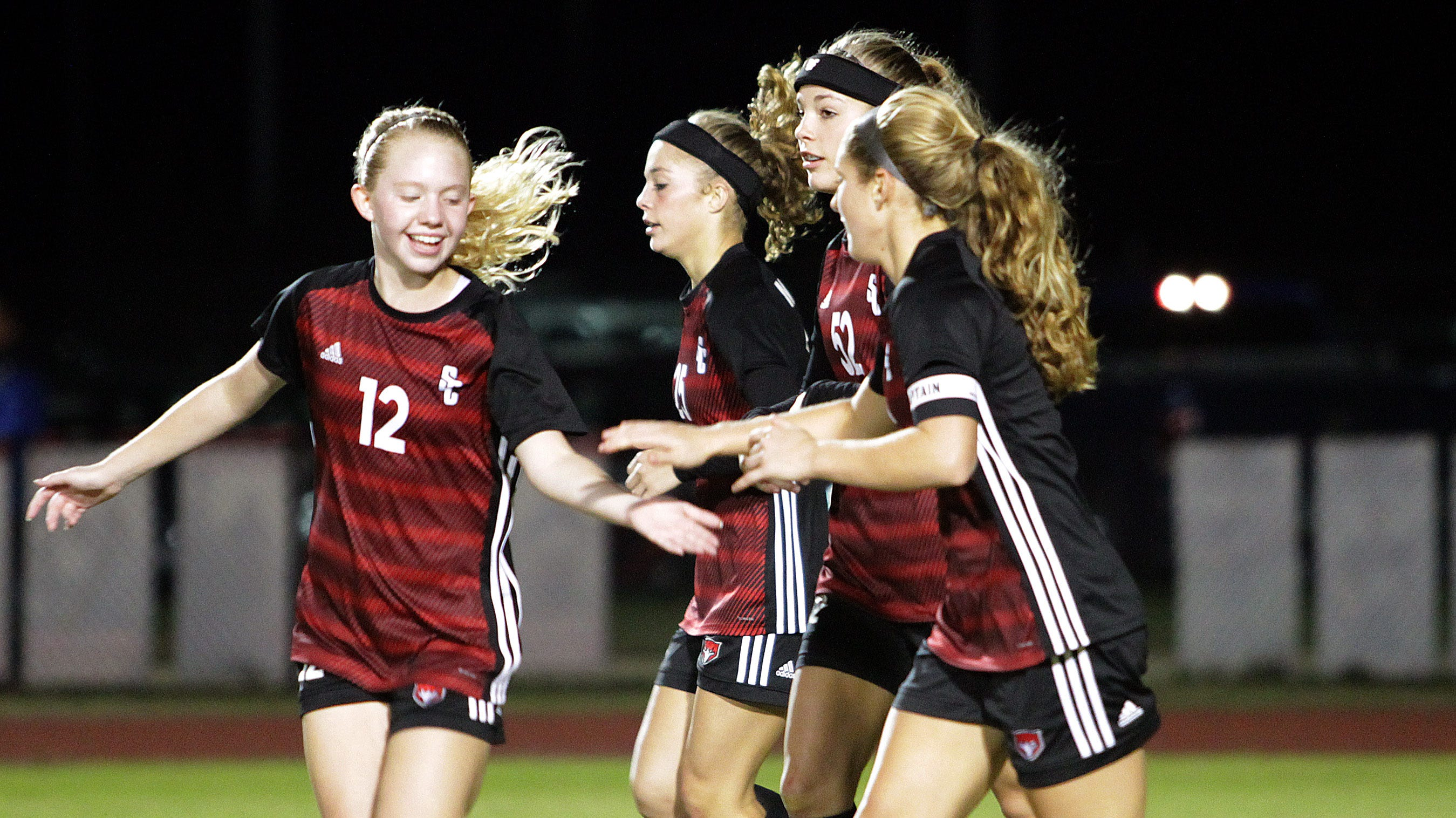 Stewarts Creek's Olivia Marlow gives fives after a Red Hawks score against Soddy-Daisy on Saturday, October 20, 2018.