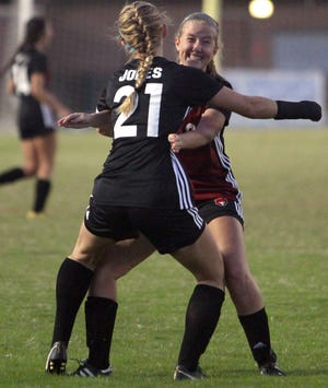 Stewarts Creek's Kaitlin Jones gets a hug from Emily Meyer after scoring the games first goal against Soddy-Daisy on Saturday, October 20, 2018.