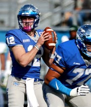 MTSU's quarterback Brent Stockstill (12) looks for a player to pass to during the game against Charlotte, on Saturday, Oct. 20, 2018.