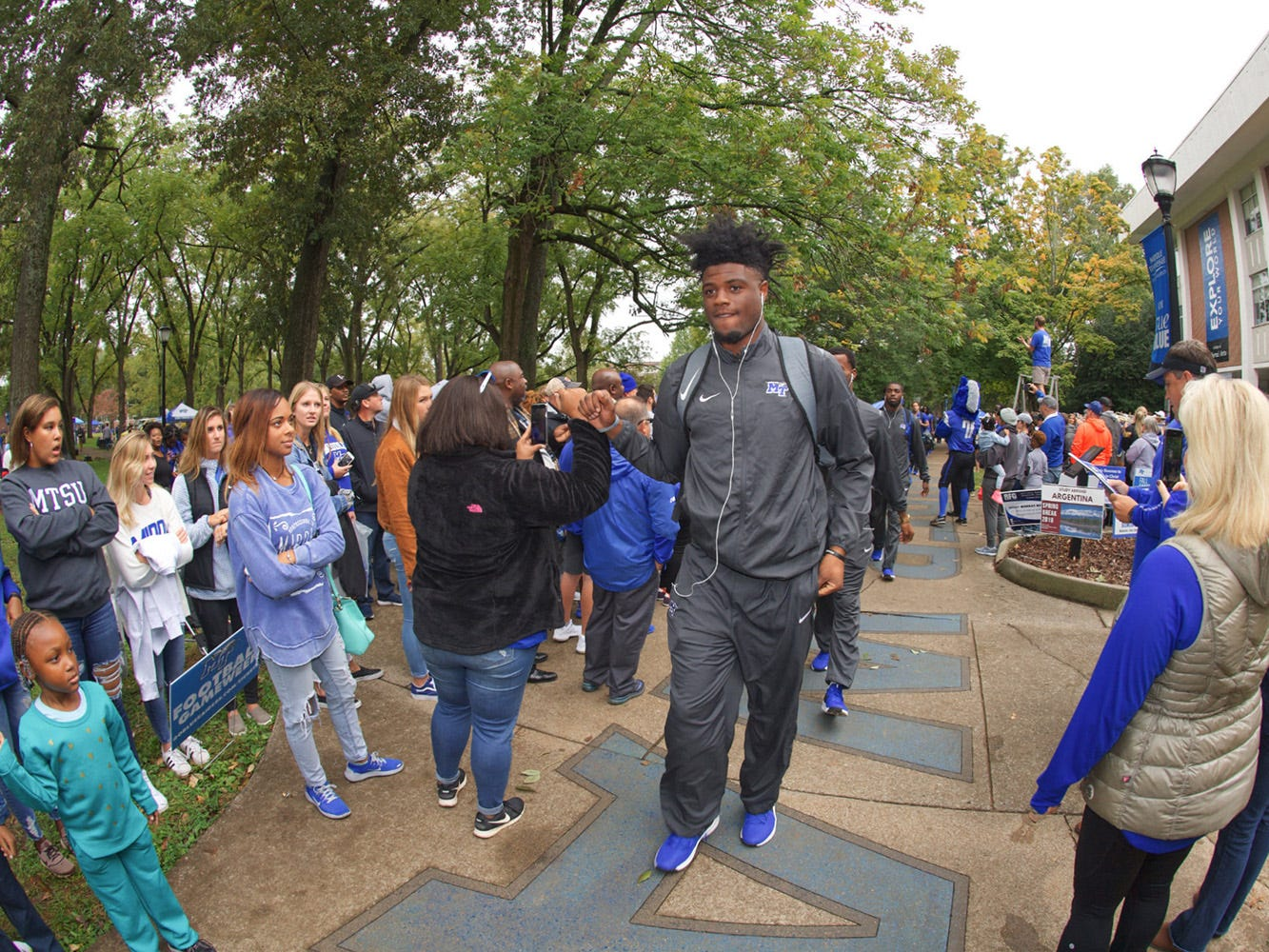 MTSU players participate in the Raider Walk during tailgating in The Grove during MTSU's Homecoming celebration on Oct. 20, 2018.