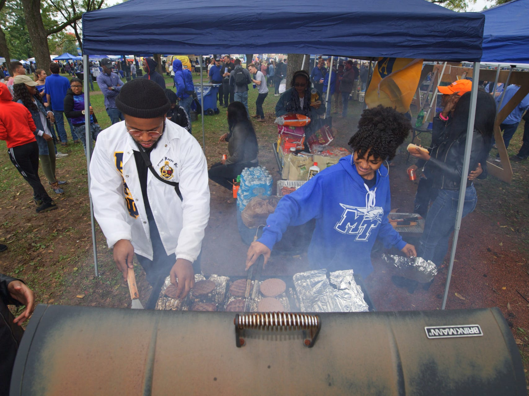 Tailgaters work the grill during MTSU's 2018 Homecoming celebration.