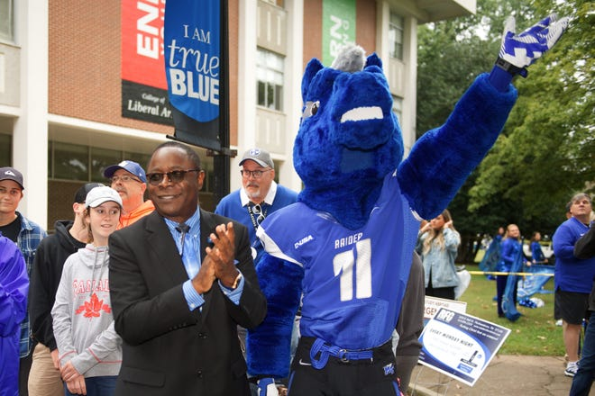 MTSU President Sidney McPhee and Lightning celebrate during the Raider Walk 2018 at Homecoming.